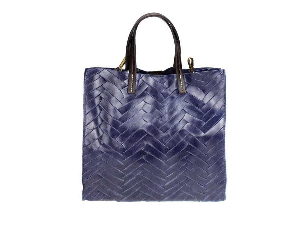 Large, useful, eye catching bag in shiny leather, with a matching cosmetic bag.