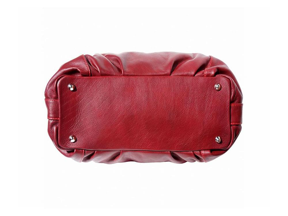 Cremona (bordeaux) - soft, calf leather hobo style bag - base, showing the protective metal studs