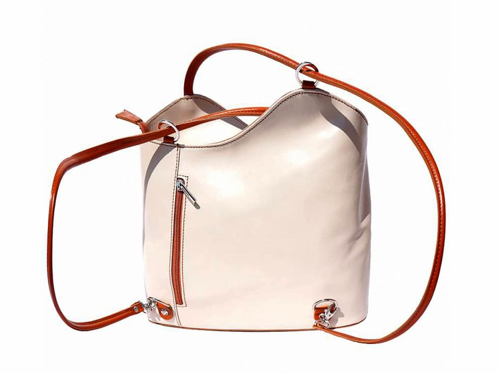 Capri - versatile handbag in rigid, cream and tan leather - back view with handles in backpack configuration