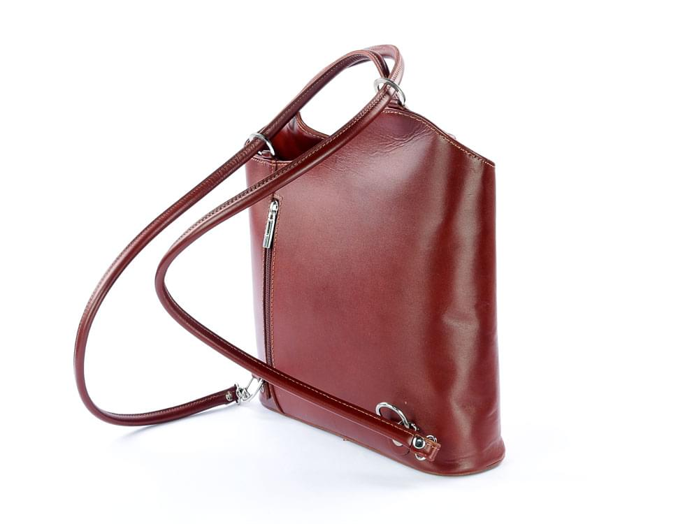 Capri - versatile handbag in rigid leather - showing the handles in the backpack position