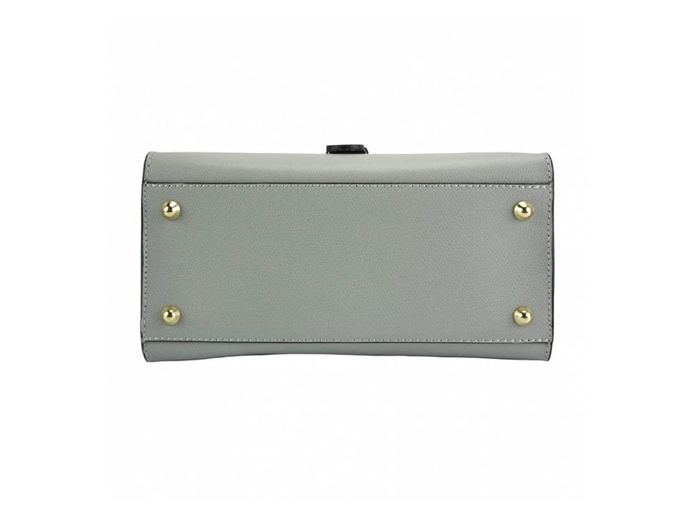 Montone - timeless design with modern details - the base, showing the four metal studs